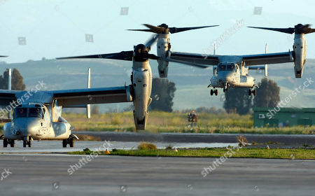 Two MV-22 Osprey vertical take off and lift aircraft land, one carrying US General Carter Ham, Commander of the United States military mission in Libya, in the Sigonella airbase, Sicily