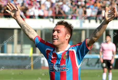 Catania's Simone Pesce celebrates after scoring during a Serie A soccer match between Catania and Palermo, at Catania's Angelo Massimino stadium, Italy, . Catania won 4-0
