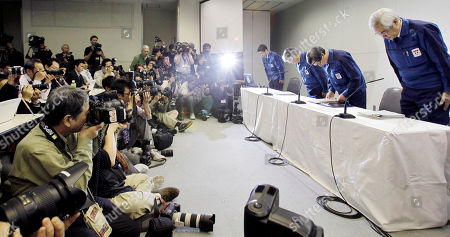 Stock Photo of Masataka Shimizu, Sakae Muto, Takashi Fujimoto Tokyo Electric Power Co. (TEPCO) President Masataka Shimizu, second from right, accompanied by, TEPCO Executive Vice Presidents, Sakae Muto, right, and Takashi Fujimoto, second from left, bows to express his apology prior to the press conference at the TEPCO headquarters in Tokyo . Shimizu and other company executives bowed in apology on Wednesday as Shimizu pledged to do more to help compensate residents unable to return home or work due to the accident at the tsunami-hit Fukushima Dai-ichi nuclear power plant, northeastern Japan