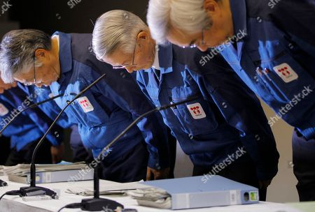 Tokyo Electric Power Co., (TEPCO) then Chairman Tsunehisa Katsumata, center, with then Vice President Sakae Muto, right, bows before a news conference at the company's head office in Tokyo. Three former Japanese utility executives, including Katsumata and Muto, were formally charged for alleged negligence in the Fukushima nuclear disaster, becoming the first ones from the company to face a criminal court