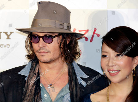 """Johnny Depp, Miki Maya U.S. actor Johnny Depp, left, pose with Japanese actress Miki Maya during a photo session at a news conference to promote his film """"The Tourist"""" in Tokyo . Depp was here for the Japan premiere of the spy thriller which also stars Angelina Jolie"""