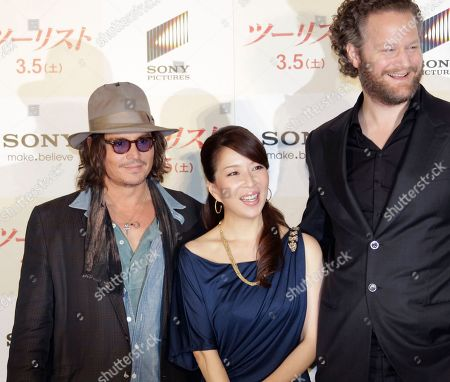 """Stock Image of Johnny Depp, Miki Maya, Florian Henckel von Donnersmarck U.S. actor Johnny Depp, left, and director Florian Henckel von Donnersmarck, right, smile with Japanese actress Miki Maya during a photo session at a news conference to promote their film """"The Tourist"""" in Tokyo . Depp was here for the Japan premiere of the spy thriller which also stars Angelina Jolie"""