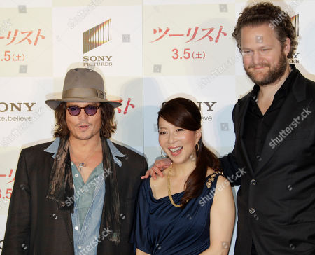 """Johnny Depp, Miki Maya, Florian Henckel von Donnersmarck U.S. actor Johnny Depp, left, and director Florian Henckel von Donnersmarck, right, pose with Japanese actress Miki Maya during a photo session at a news conference to promote their film """"The Tourist"""" in Tokyo . Depp was here for the Japan premiere of the spy thriller which also stars Angelina Jolie"""