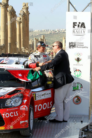 Petter Solberg, Prince Faisal WRC driver Petter Solberg, left, chats with Jordan's Prince Faisal, left, during the opening ceremony of the 4th round of the FIA World Rally Championship, at the ancient city of Jerash, 55 kilometers (32 miles) north Amman, Jordan, Thursday, April, 14, 2011