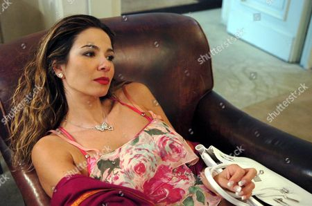 Luciana Morad relaxing in her room at the Hotel de Russie