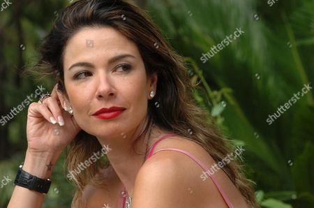Luciana Morad relaxing in the gardens at the Hotel de Russie