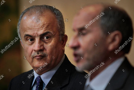 Abdelilah Al-Khatib, Mustafa Abdul-Jalil U.N. envoy Abdelilah Al-Khatib, left, and Mustafa Abdul-Jalil, right, head of the opposition's interim governing council based in Benghazi, attend a joint press conference in Benghazi, Libya . Libya's rebels will agree to a cease-fire if Moammar Gadhafi pulls his military forces out of cities and allows peaceful protests against his regime, the opposition leader said Friday