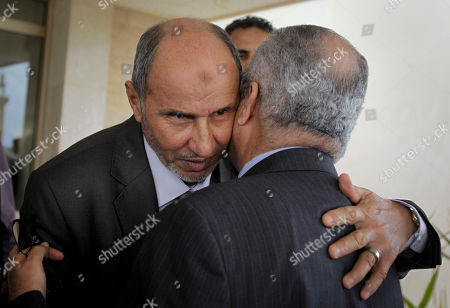 Abdelilah Al-Khatib, Mustafa Abdul-Jalil Mustafa Abdul-Jalil, center-left, head of the opposition's interim governing council based in Benghazi, hugs U.N. envoy Abdelilah Al-Khatib, center-right, as Al-Khatib leaves after attending a joint press conference in Benghazi, Libya . Libya's rebels will agree to a cease-fire if Moammar Gadhafi pulls his military forces out of cities and allows peaceful protests against his regime, the opposition leader said Friday