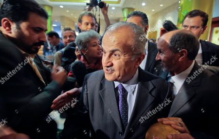 Abdelilah Al-Khatib, Mustafa Abdul-Jalil U.N. envoy Abdelilah Al-Khatib, center, and Mustafa Abdul-Jalil, right, head of the opposition's interim governing council based in Benghazi, leave after attending a joint press conference in Benghazi, Libya . Libya's rebels will agree to a cease-fire if Moammar Gadhafi pulls his military forces out of cities and allows peaceful protests against his regime, the opposition leader said Friday
