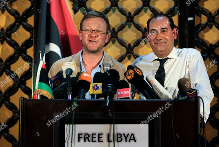 Jason McCue, Mark Muller Jason McCue, a London lawyer representing Lockerbie victims, left, and Mark Muller QC, right, Chairman of the Bar Human Rights Committee of England and Wales, speak to the media about developments surrounding the Lockerbie plane crash, at a hotel in Benghazi, Libya