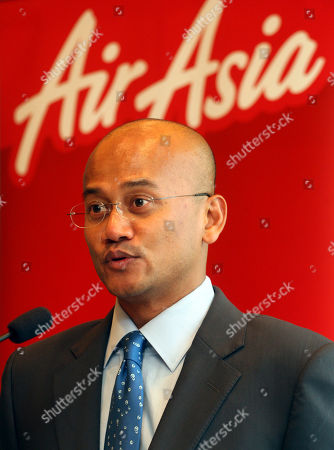 Azran Osman-Rani AirAsia X Chief Executive Azran Osman-Rani speaks during a signing ceremony between AirAsia X and Airbus in Kuala Lumpur, Malaysia, . Malaysia's long-haul budget carrier AirAsia X has inked a pact to buy three more Airbus A330 planes as part of its global expansion