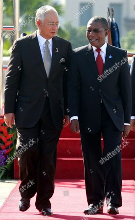 Pakalitha Mosisili, Najib Razak Lesotho's Prime Minister Pakalitha Mosisili, right, walks with his Malaysia's counterpart Najib Razak during an official welcoming ceremony in Putrajaya, Malaysia, . Mosisili is in Malaysia on a four-day official visit