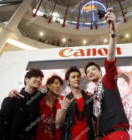 """Calvin Chen, Aaron Yan, Jiro Wang, Wu Chun Taiwanese boy band Fahrenheit, from left, Aaron Yan, Wu Chun, Jiro Wang and Calvin Chen, take a photo of themselves during """"Meet the Fans"""" session at a shopping mall in Kuala Lumpur, Malaysia"""