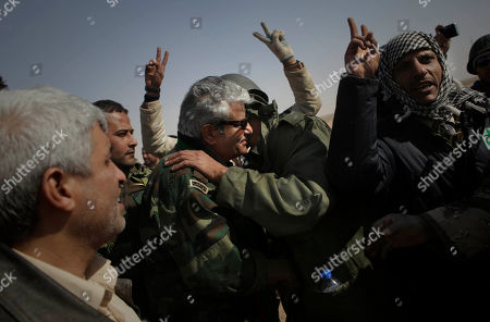 Stock Picture of General Abdel-Fattah Younis, former interior minister in the Gadhafi regime who defected early, is greeted by Libyan rebels at the front line near Brega, Libya