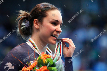 Silver medallist Sandie Clair of France bites her medal on the podium of the women's 500 meters time trial during the Track Cycling World Championships in Apeldoorn, central Netherlands