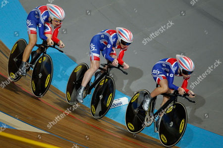 Team Britain with Laura Trott, leading, Wendy Houvenaghel, center, and Danielle King, left, competes to set the fastest time in the qualifying session of the women's team pursuit event during the Track Cycling World Championships in Apeldoorn, central Netherlands