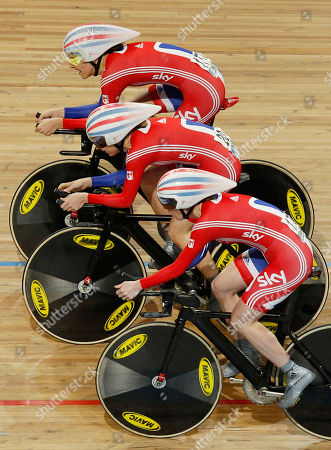 Team Britain with Laura Trott, center, Wendy Houvenaghel, bottom, and Danielle King, top, strain in the last lap to set the fastest time in the qualifying session of the women's team pursuit event during the Track Cycling World Championships in Apeldoorn, central Netherlands