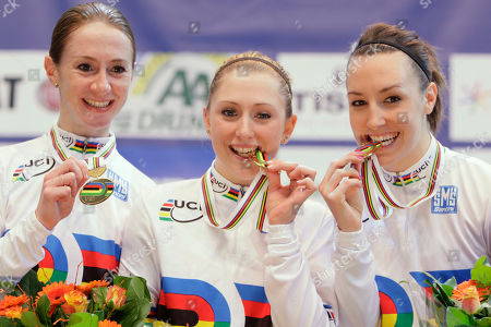 Team Britain with Wendy Houvenaghel, Laura Trott and Danielle King, left to right, hold their medals on the podium of the women's team pursuit event during the Track Cycling World Championships in Apeldoorn, central Netherlands