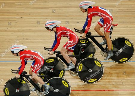 Team Britain with Laura Trott, bottom, Wendy Houvenaghel, center, and Danielle King, top, take the start to set the fastest time in the qualifying session of the women's team pursuit event during the Track Cycling World Championships in Apeldoorn, central Netherlands