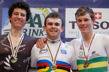 Silver medallist Jesse Sergent of New Zealand, gold medallist Jack Bobridge of Australia, and bronze medallist Michael Hepburn of Australia, left to right, pose on the podium of the men's individual pursuit during the Track Cycling World Championships in Apeldoorn, central Netherlands