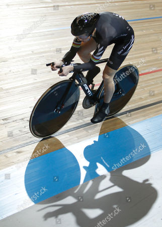 Alison Shanks of New Zealand casts a shadow as she competes in the qualifying session of the women's individual pursuit during the Track Cycling World Championships in Apeldoorn, central Netherlands