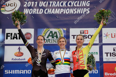 New world champion Sarah Hammer of Temecula, Ca., USA, center, silver medallist Alison Shanks of new Zealand, left, and bronze medallist Vilija Sereikaite of Lithuania, right, greet the crowd on the podium of the women's individual pursuit event during the Track Cycling World Championships in Apeldoorn, central Netherlands