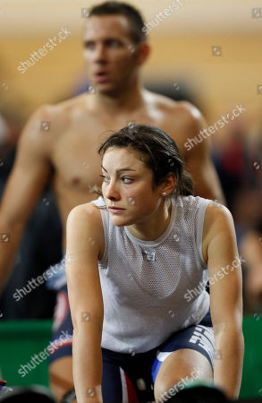 Pascale Jeuland, front, and Francois Pervis, rear, of France, look up as they exercise prior to competing during the Track Cycling World Championships in Apeldoorn, central Netherlands