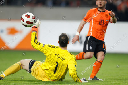 Wesley Sneijder of The Netherlands scores 2-2 passing Hungary's goalkeeper Marton Fulop during the Euro 2012 group E qualifying match Netherlands against Hungary at ArenA stadium in Amsterdam, Netherlands
