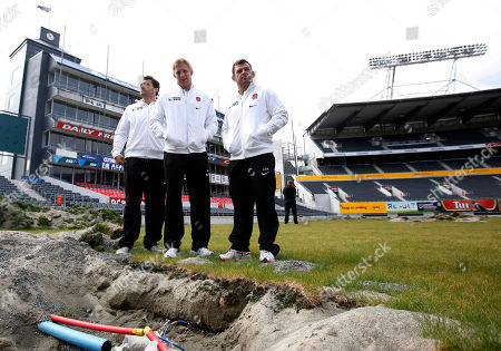 England rugby players from left Alex Corbisiero, captain Lewis Moody and Lee Mears stand on the damaged pitch of the AMI Stadium in Christchurch, New Zealand, Wednesday, Sept., 7, 2011. Christchurch was to have been the base for the England team for the upcoming Rugby World Cup. However due to the earthquake of, and the damage done to infrastructure, hotels and stadium, their base and all their matches have been moved away from Christchurch