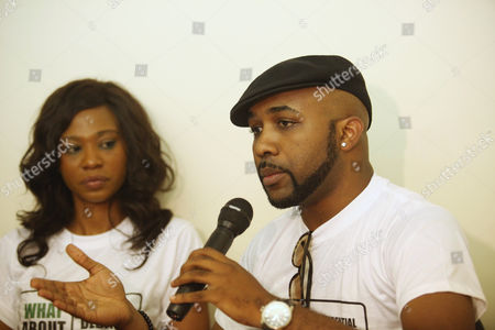 Banky .W, Artist, right, and Nse Etim, a Nollywood actress, left, speak during a press conference for a youth-oriented group called What About Us? in Abuja, Nigeria, . In Nigeria's young democracy, the major debate over the coming presidential election appears to be whether to have a debate at all. A youth-oriented group called What About Us? on Wednesday called for a debate between presidential contenders. A satellite television news channel has its own scheduled debate to bring President Goodluck Jonathan and other top candidates together. Jonathan's ruling People's Democratic Party so far has rejected the offers