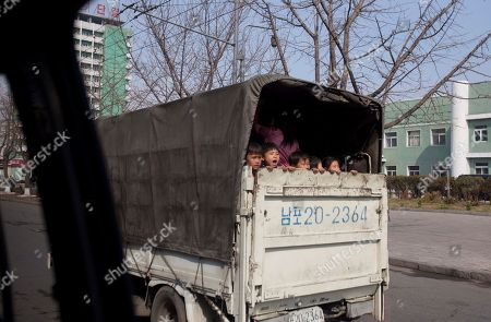 North Korean children ride in the back of a truck near the town of Nampho, North Korea. It's hard to imagine a North Korea without Kim Jong Il, who led the nation for 17 years until his death on Dec. 17. His death marks the end of an era for North Korea, which has known only two leaders: Kim and his father, Kim Il Sung. Already, a new era has begun under the leadership of his young son, Kim Jong Un. Still, Kim Jong Il's presence is felt in every frame of a series of images made by Associated Press photographer David Guttenfelder. During the last months of Kim's life, Guttenfelder, along with AP Korea Bureau Chief Jean H. Lee, made several trips to North Korea