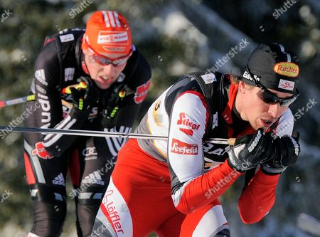 Felix Gottwald, Eric Frenzel Austria's Felix Gottwald, right, competes in front of Germany's Eric Frenzel, left, during the men nordic combined team gundersen 4x5 km at the Ski World Championships in Oslo, Norway, on . Austria won the competition, Germany placed second