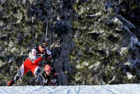 Tino Edelmann, Mario Stecher Austria's Felix Gottwald, left, competes in front of Germany's Eric Frenzel, right, during the men nordic combined team gundersen 4x5 km at the Ski World Championships in Oslo, Norway, on . Austria won the competition, Germany placed second