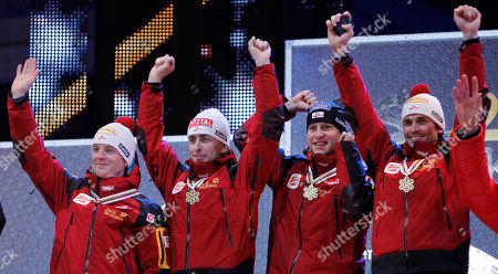 Mario Stecher, David Kreiner, Bernhard Gruber, Felix Gottwald Austria's David Kreiner, from left, Mario Stecher, Bernhard Gruber and Felix Gottwald pose with their gold medals during the medal ceremony after the men nordic combined team gundersen 4x5 km at the Ski World Championships in Oslo, Norway, on