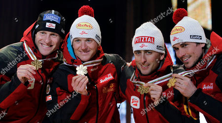 Mario Stecher, David Kreiner, Bernhard Gruber, Felix Gottwald Austria's Bernhard Gruber, from left, David Kreiner, Mario Stecher and Felix Gottwald pose with their gold medals during the medal ceremony after the men nordic combined team gundersen 4x5 km at the Ski World Championships in Oslo, Norway, on
