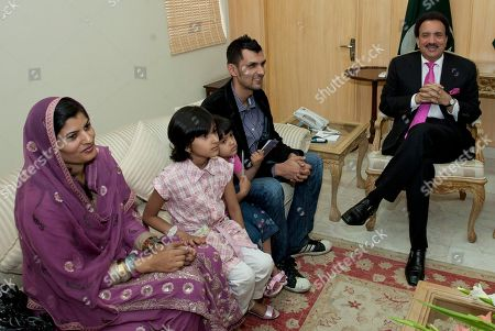 Pakistani wicketkeeper Zulqarnain Haider, second from right, meets with Pakistani Interior Minister Rehman Malik, right, with his wife Shazia Haider and daughters, Fizza Haider, second from right and Zara Haider, upon his arrival in Islamabad, Pakistan, as he ended his exile and returned home from Britain . Haider fled to Britain from Dubai in November 2010 during a One Day cricket series saying he received death threats from match fixers