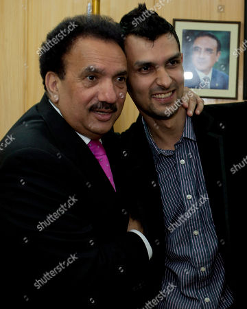 Pakistani wicketkeeper Zulqarnain Haider, right, and Pakistani Interior Minister Rehman Malik upon his arrival in Islamabad, Pakistan, as he ended his exile and returned home from Britain . Haider fled to Britain from Dubai in November 2010 during a One Day cricket series saying he received death threats from match fixers