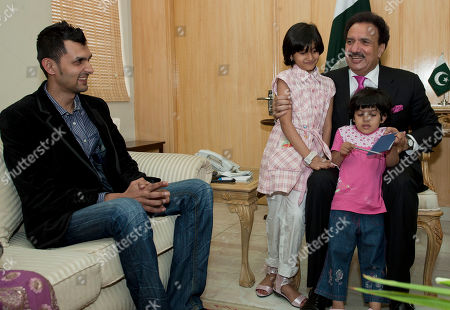 Pakistani wicketkeeper Zulqarnain Haider, left, looks at Pakistani Interior Minister Rehman Malik with his children Fizza Haider, center, and Zara Haider upon his arrival in Islamabad, Pakistan, as he ended his exile and returned home from Britain . Haider fled to Britain from Dubai in November 2010 during a One Day cricket series saying he received death threats from match fixers