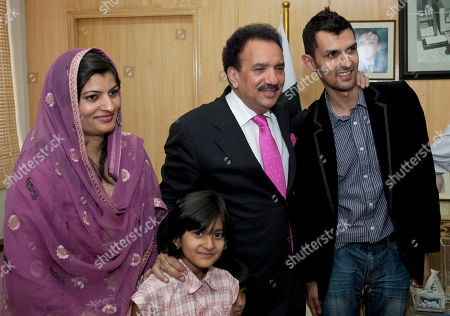 Pakistani wicketkeeper Zulqarnain Haider, right, with his wife Shazia Haider, left and daughter Fizza Haider poses with Pakistani Interior Minister Rehman Malik upon his arrival in Islamabad, Pakistan, as he ended his exile and returned home from Britain . Haider fled to Britain from Dubai in November 2010 during a One Day cricket series saying he received death threats from match fixers