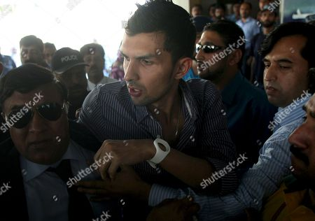 Stock Photo of Zulqarnain Haider Pakistani wicketkeeper Zulqarnain Haider, center, is whisked away by security personals upon his arrival, as he ended his exile and returned home from Britain Monday, l at Islamabad airport on in Pakistan. Haider fled to Britain from Dubai in November 2010 during a One Day cricket series saying he received death threats from match fixers