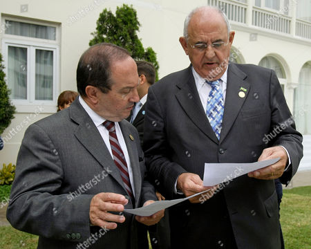 Nelson Jobim, Javier Ponce Brazil's Defense Minister Nelson Jobim, right, and Ecuador's Defense Minister Javier Ponce compare documents during the III Ordinary Meeting of the South American Defense Council in Lima, Peru, . The South American Defense Council is part of the South American Union of Nations, UNASUR, created in 2008 and constituted of Argentina, Bolivia, Brazil, Chile, Colombia, Ecuador, Guyana, Paraguay, Peru, Surinam, Uruguay and Venezuela