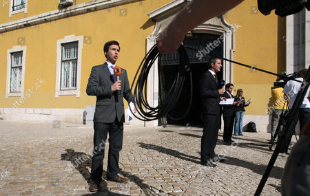 Fernando Teixeira dos Santos Television journalists report live from outside the Portuguese finance ministry, in Lisbon. A delegation from the International Monetary Fund, European Central Bank and European Commission, bodies that will raise the estimated euro 80 billion ($115.5 billion) bailout for Portugal and oversee its use, was expected in Lisbon on Tuesday for initial talks