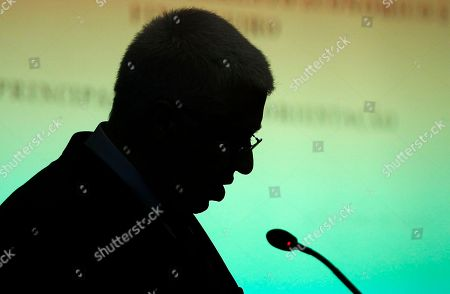 Fernando Teixeira dos Santos Portuguese Finance Minister Fernando Teixeira dos Santos, seen in silhouette, talks to journalists during a news conference in Lisbon. Portugal will get IMF loans at rates similar to those granted to Greece and Ireland, officials said Thursday, but Lisbon is still waiting for fellow European countries to decide how much they'll charge for their slice of a euro78 billion ($115 billion