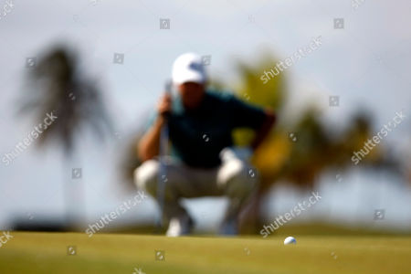 Hunter Haas U.S.' Hunter Haas eyes his putt on the 17th hole green during the final round of the Puerto Rico Open PGA golf tournament in Rio Grande, Puerto Rico