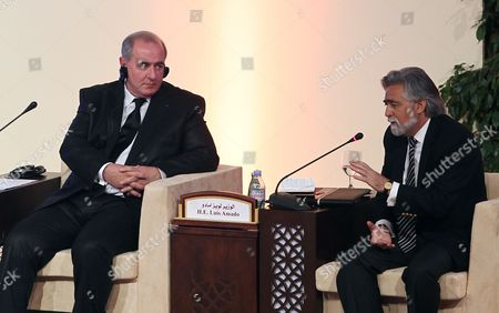 "Portuguese Foreign Minister Luis Amado, right, and France's Urban Development Minister Maurice Leroy attend a conference: ""Enriching The Middle East's Economic Future"" in Doha"