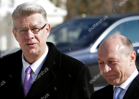 Latvia's President Valdis Zatlers, left, looks on while walking with Romanian counterpart Traian Basescu during a welcoming ceremony at the Cotroceni Presidential Palace in Bucharest, Romania