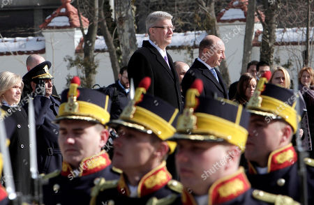 Latvia's President Valdis Zatlers, rear left, observes an honor guard with Romanian counterpart Traian Basescu during a welcoming ceremony at the Cotroceni Presidential Palace in Bucharest, Romania