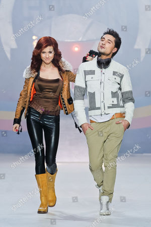 Anna Chapman, Dima Bilan On, Anna Chapman, left, who was deported from the U.S. on charges of espionage, and Russian pop singer and Eurovision 2008 contest winner Dima Bilan display a creation by Russian designers Shiyan & Rudkovskaya during a Fashion Week in Moscow, Russia, Sunday, April 3, 2011
