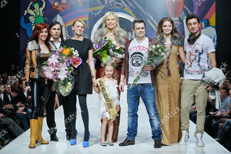 Anna Chapman, Alexander Revva, Yana Rudkovskaya, Natasha Ragozina, Ilya Shiyan, Dima Bilan, Evelina Voznesenskaya In this image taken, from left, Anna Chapman, who was deported from the U.S. on charges of espionage, showman Alexander Revva, producer Yana Rudkovskaya, Evelina Voznesenskaya, front, professional boxer Natascha Ragosina, designer Ilya Shiyan, a model, Russian pop singer and Eurovision 2008 contest winner Dima Bilan display a creation by Russian designers Shiyan & Rudkovskaya during a Fashion Week in Moscow, Russia