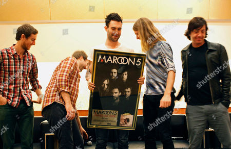 """Maroon 5 Members of American rock band Maroon 5, from left, Jesse Carmichael, Mickey Madden, Adam Levine, James Valentine and Matt Flynn, give a press conference at the Singapore Indoor Stadium before their concert as part of their tour in support of their album """"Hands All Over"""" on in Singapore"""